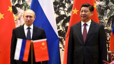 Putin's caravan of CEOs goes courting in China