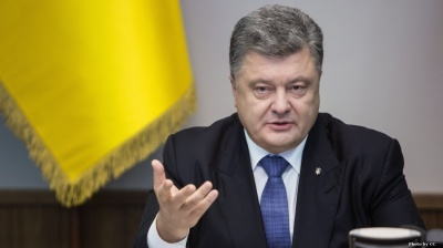 Ukraine's Poroshenko threatens to impose martial law if situation in east deteriorates