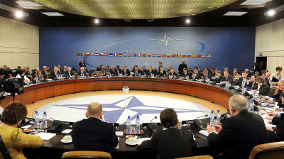 Nato leaders talk tough on Russia as sides build up military on borders