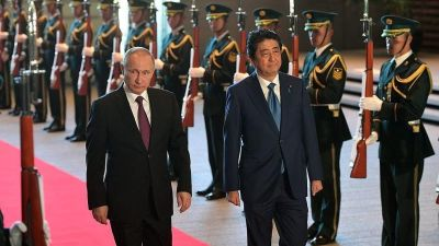 Putin and Abe make limited progress on disputed islands in Japan