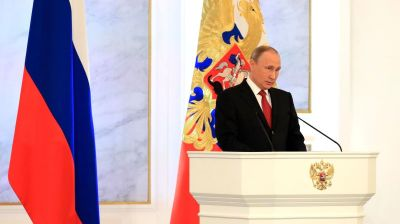 Russia uncowed and heading back to growth, Putin declares in annual address