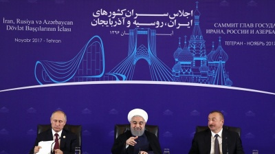 Iran, Russia display strategic unity and envision huge oil deal as Putin visits Tehran
